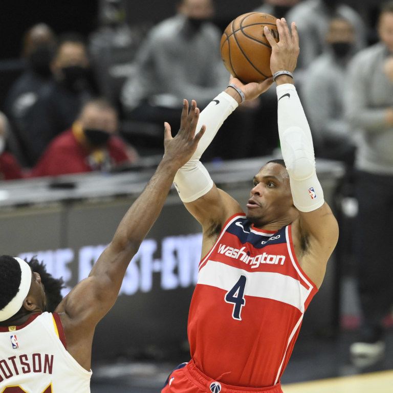Washington Wizards guard Russell Westbrook shoots beside Cleveland Cavaliers guard. Mandatory Credit: David Richard-USA TODAY Sports