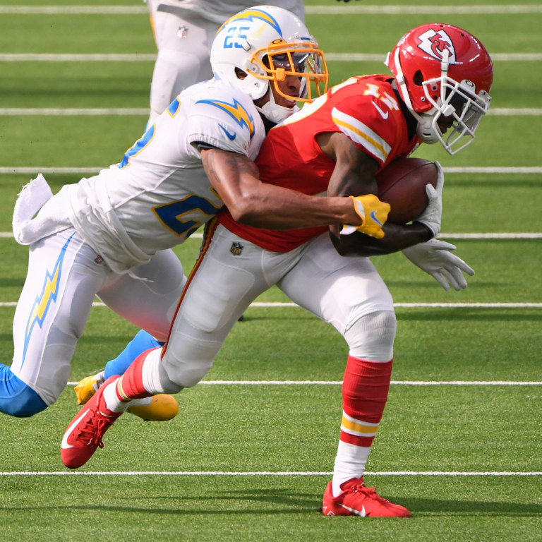 Los Angeles Chargers cornerback Chris Harris (25) tackles Kansas City Chiefs wide receiver Mecole Hardman (17) during the second half at SoFi Stadium. Mandatory Credit: Robert Hanashiro-USA TODAY Sports