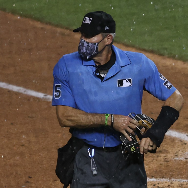 Home plate umpire umpire Angel Hernandez (5) walks off the field at Nationals Park. Mandatory Credit: Geoff Burke-USA TODAY Sports