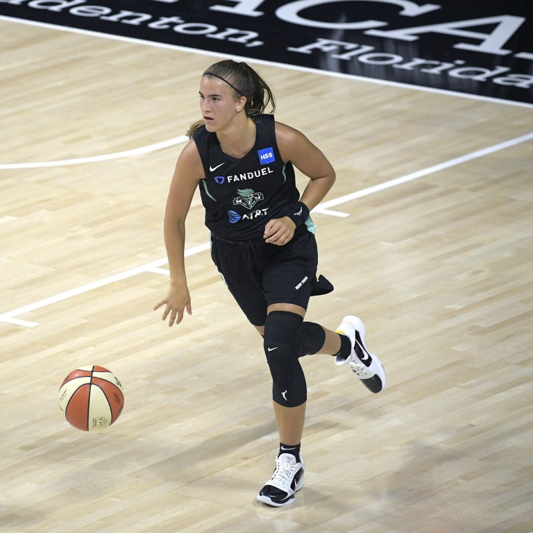 In this file photo, New York Liberty guard Sabrina Ionescu brings the ball up against the Seattle Storm in Bradenton, Fla. (AP Photo/Phelan M. Ebenhack, File)