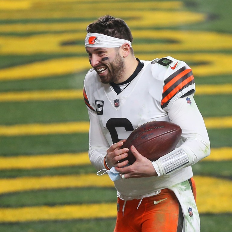 Browns quarterback Baker Mayfield rushes back to the locker room after beating the Pittsburgh Steelers in an NFL wild-card playoff football game. [Jeff Lange/Beacon Journal]