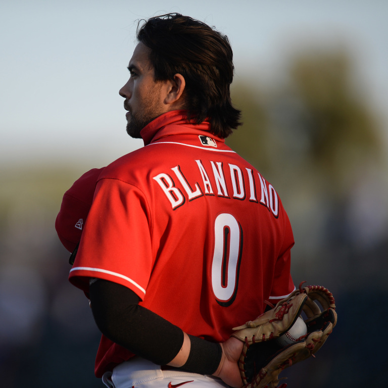 Cincinnati Reds shortstop Alex Blandino looks on during the playing of the national anthem at Goodyear Ballpark. Mandatory Credit: Joe Camporeale-USA TODAY Sport