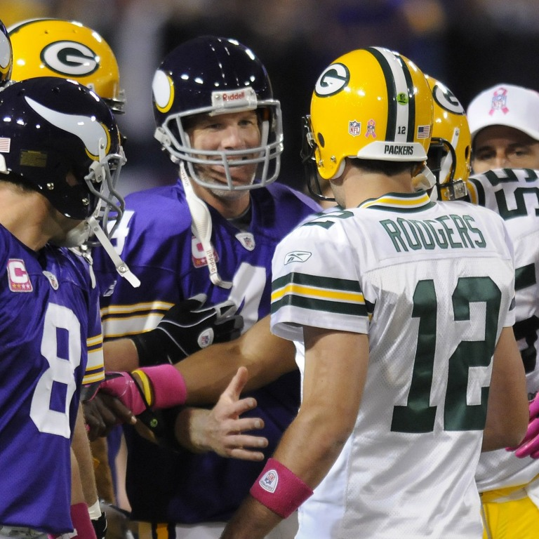 Green Bay Packers quarterback Aaron Rodgers (12) meets with Minnesota Vikings quarterback Brett Favre at midfield on Oct. 5, 2009, at the Metrodome in Minneapolis. Photo by Evan Siegle/Press-Gazette