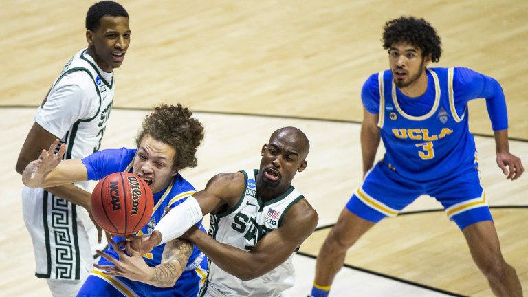 UCLA's Mac Etienne competes for a rebound with Michigan State's Joshua Langford. (AP Photo/Robert Franklin)