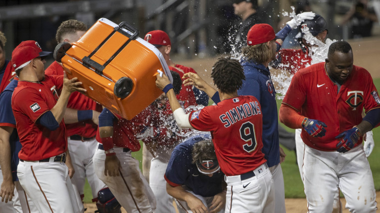 Thursday, June 10: Twins designated hitter Nelson Cruz (23) celebrates with teammates after hitting a two run walk off home run in the ninth inning against the New York Yankees at Target Field.
