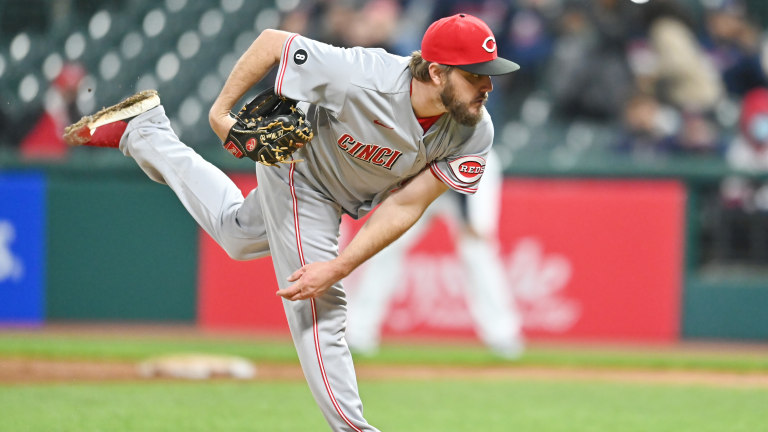 Cincinnati Reds starting pitcher Wade Miley (22) throws a pitch during the ninth inning against the Cleveland Indians at Progressive Field. Mandatory Credit: Ken Blaze-USA TODAY Sports