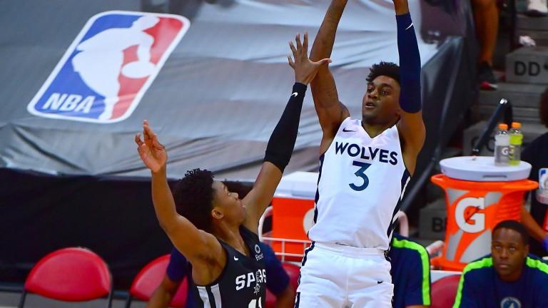 Monday, Aug. 9: Timberwolves forward Jaden McDaniels (3) shoots the ball over San Antonio Spurs guard Joshua Primo (11) during an NBA Summer League game at Cox Pavilion.