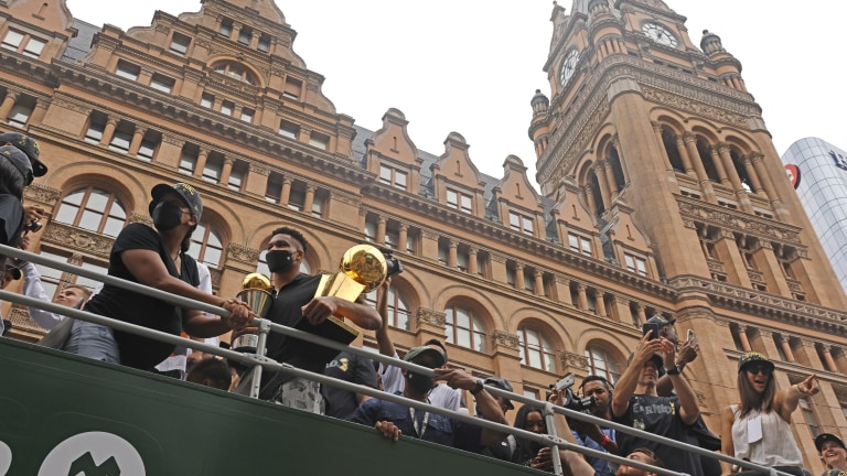 Giannis Antetokounmpo brought along the NBA championship and his MVP finals trophies. (AP Photo/Jeffrey Phelps)