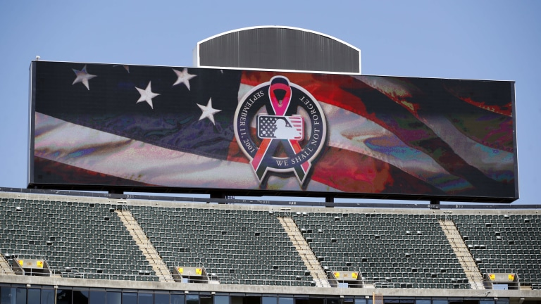 The main scoreboard displays the logo to commemorate 9/11 before the game between the Oakland Athletics and the Texas Rangers at RingCentral Coliseum. (Darren Yamashita-USA TODAY Sports)