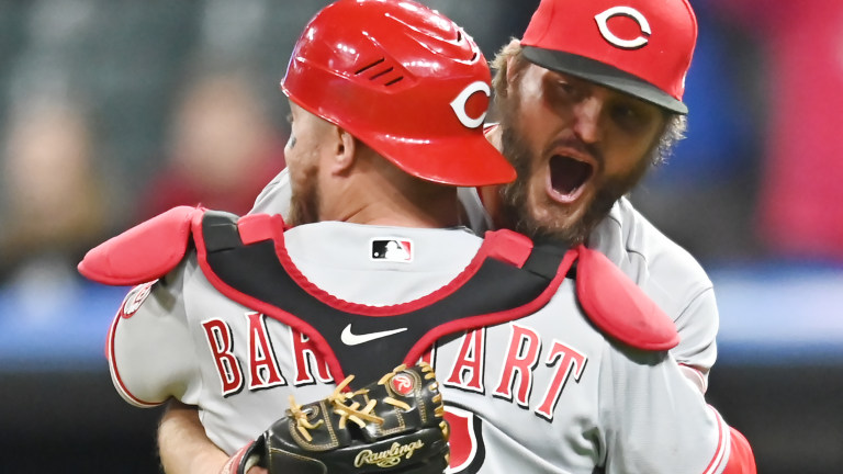 Cincinnati Reds starting pitcher Wade Miley and catcher Tucker Barnhart celebrate after Miley threw a no-hitter against the Cleveland Indians. Mandatory Credit: Ken Blaze-USA TODAY Sports