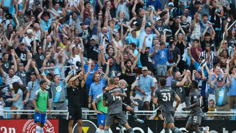 Saturday, July 3: Minnesota United players celebrate a goal by defender Brent Kallman (14) against the San Jose Earthquakes in the first half at Allianz Field.