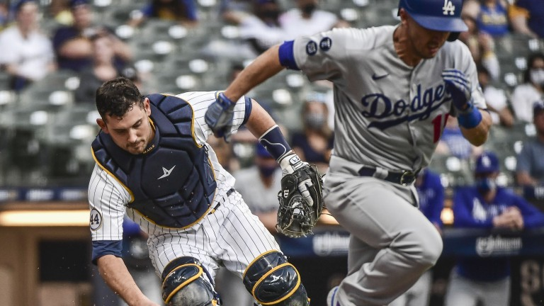 Saturday, May 1: Brewers catcher Luke Maile darts to pick up the ball and throw out Dodgers catcher Austin Barnes.