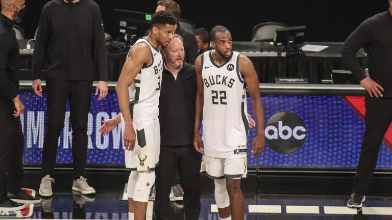 Mike Budenholzer stands with forward Giannis Antetokounmpo (34) and forward Khris Middleton (22) after defeating the Brooklyn Nets in overtime in game seven in the second round of the 2021 NBA Playoffs at Barclays Center. Mandatory Credit: Wendell Cruz-USA TODAY Sports