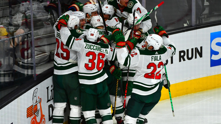 Sunday, May 16: Teammates mob forward Joel Eriksson Ek after his overtime goal gave the Minnesota Wild a 1-0 victory over the Vegas Golden Knights and a 1-0 lead in the playoff series.
