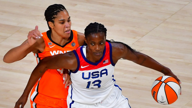 Team USA center and Lynx star Sylvia Fowles (13) dribbles around WNBA All Star forward Brionna Jones (42) during the WNBA All Star Game at Michelob Ultra Arena at Mandalay Bay Resort.