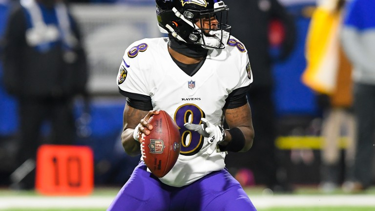 Baltimore Ravens quarterback Lamar Jackson drops back to pass against the Buffalo Bills during the first quarter of an AFC Divisional Round game. Mandatory Credit: Rich Barnes-USA TODAY Sports