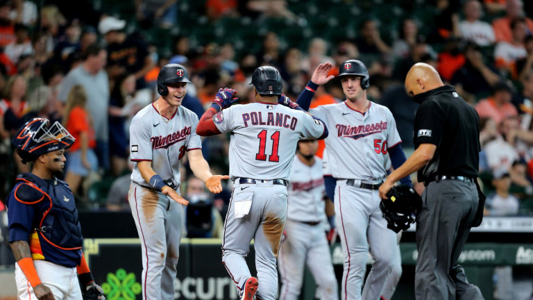 Sunday, Aug. 8: Twins shortstop Jorge Polanco (11, center) is congratulated by teammates at home plate after hitting a three-run home run against the Houston Astros at Minute Maid Park.