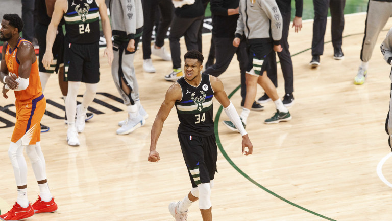 Jul 20, 2021; Milwaukee, Wisconsin, USA; Milwaukee Bucks forward Giannis Antetokounmpo (34) begins to celebrate during the fourth quarter against the Phoenix Suns during game six of the 2021 NBA Finals at Fiserv Forum. Mandatory Credit: Jeff Hanisch-USA TODAY Sports