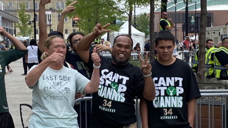 """Fans show the love with """"Can't Stop Giannis"""" T-shirts. (Bally Sports Wisconsin)"""