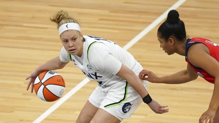 Saturday, May 8: Lynx guard Rachel Banham dribbles in the second half of a preseason game against the Washington Mystics.