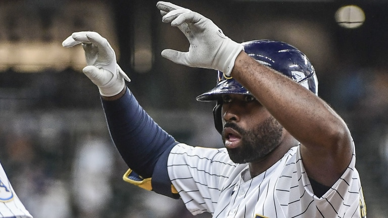 Sunday, July 11: Jackie Bradley Jr. signals to the Milwaukee dugout after he notched an RBI single in the Brewers' 3-1 loss to Cincinnati.