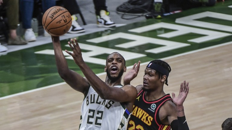 Khris Middleton (22) takes a shot against Atlanta Hawks forward Cam Reddish (22) in the second quarter during game five of the Eastern Conference Finals for the 2021 NBA Playoffs at Fiserv Forum. Mandatory Credit: Benny Sieu-USA TODAY Sports