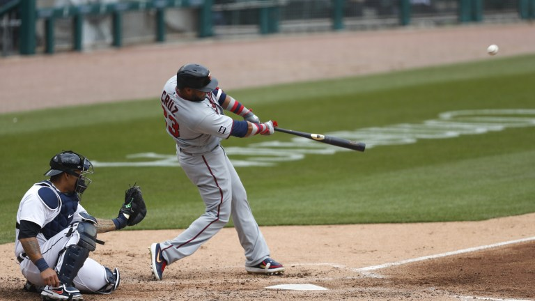 Monday, April 5: Twins designated hitter Nelson Cruz hits a home run against the Detroit Tigers at Comerica Park.