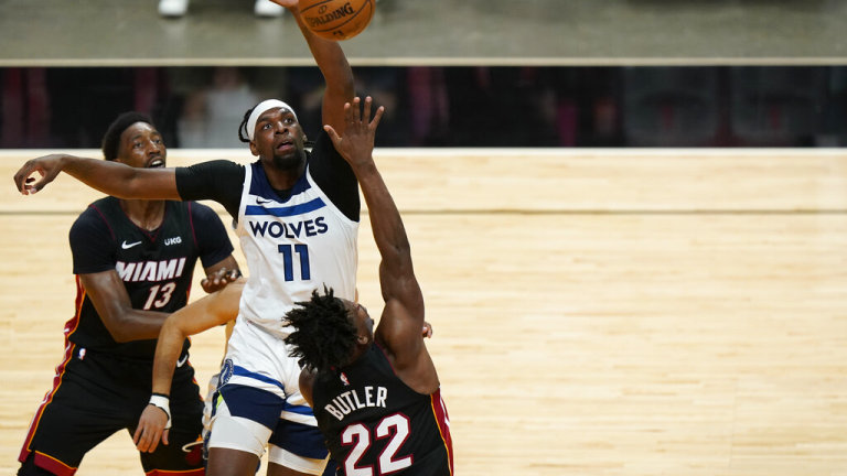 Friday, May 7: Minnesota Timberwolves center Naz Reid goes up for a block against Miami's Jimmy Butler.