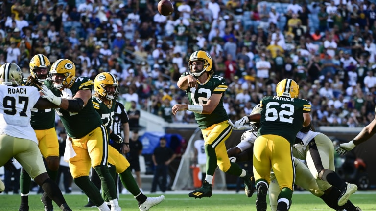 Green Bay Packers quarterback Aaron Rodgers jumps to throw during the third quarter against the New Orleans Saints at TIAA Bank Field.
