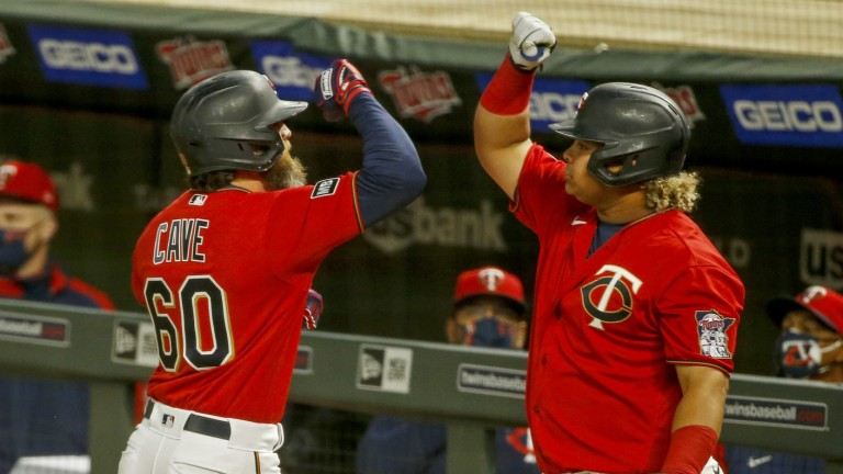Friday, April 23: Twins left fielder Jake Cave celebrates with first baseman Willians Astudillo after hitting a solo home run at Target Field.