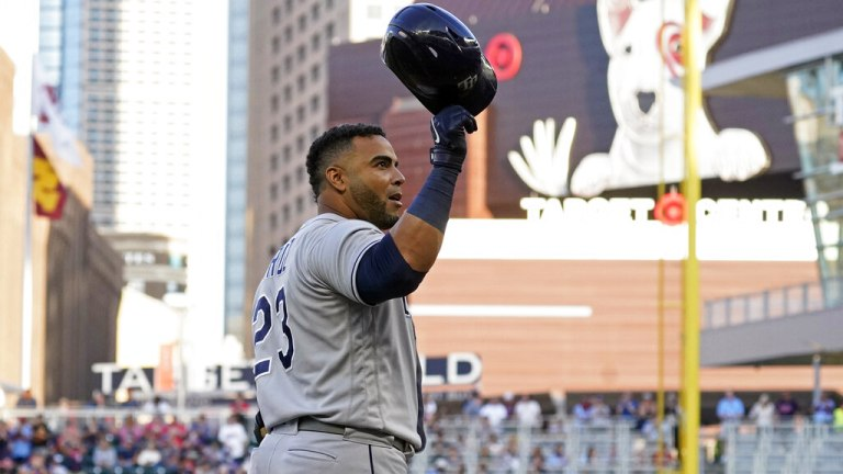 Friday, Aug. 13: Rays' Nelson Cruz doffs his helmet to cheering fans before batting in the first inning of a baseball game against the Minnesota Twins, his former team.