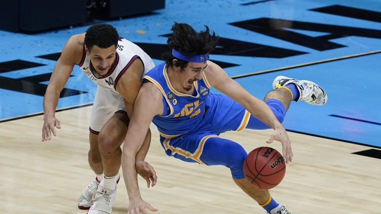 UCLA's Jaime Jaquez Jr. fights for a loose ball with Gonzaga guard Jalen Suggs. (AP Photo/Darron Cummings)