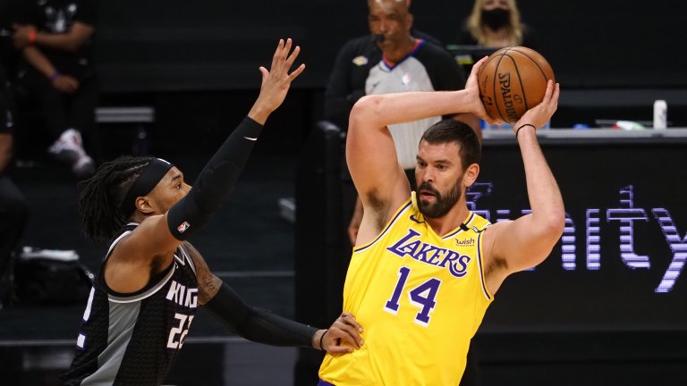 Apr 2, 2021; Sacramento, California, USA; Los Angeles Lakers center Marc Gasol (14) controls the ball against Sacramento Kings forward Richaun Holmes (22) during the first quarter at Golden 1 Center. Mandatory Credit: Kelley L Cox-USA TODAY Sports