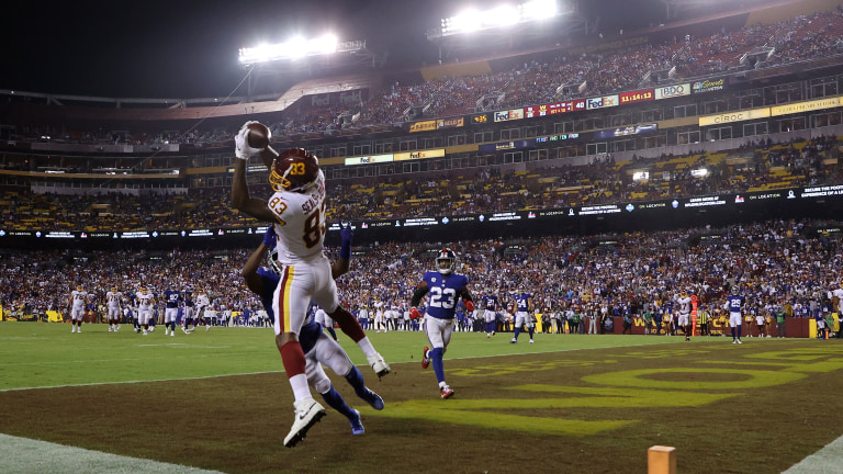 Tight end Ricky Seals-Jones makes an incredible catch over cornerback Adoree' Jackson. (Geoff Burke-USA TODAY Sports)