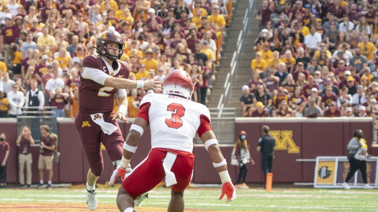 Minnesota Golden Gophers quarterback Tanner Morgan makes a pass in the second half as Miami (OH) Redhawks defensive back Mike Brown looks on at Huntington Bank Stadium.