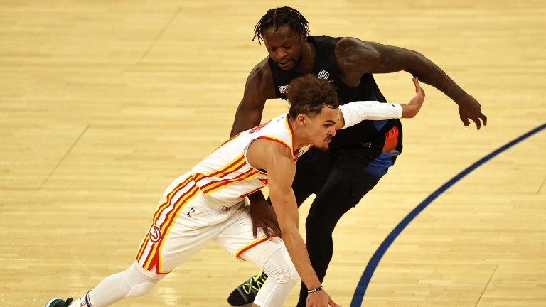 May 26, 2021; New York, New York, USA; Atlanta Hawks guard Trae Young (11) moves the ball against New York Knicks forward Julius Randle (30) during the second half of game two of the Eastern Conference quarterfinal at Madison Square Garden. Mandatory Credit: Elsa/POOL PHOTOS-USA TODAY Sports