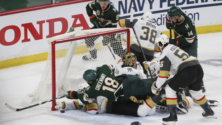 Thursday, May 20: Minnesota Wild's Jordan Greenway falls over Vegas Golden Knights' Alex Pietrangelo while trying to get the puck in the net during the third period in Game 3 of a first-round NHL hockey playoff series.