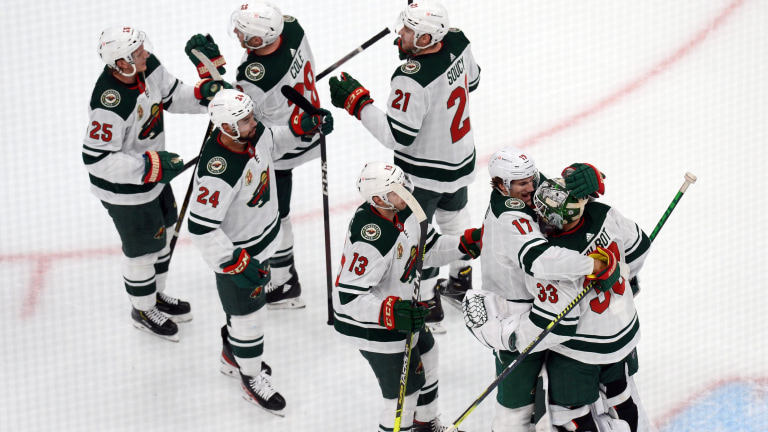 Monday, April 19: Minnesota Wild players celebrate after defeating the Arizona Coyotes at Gila River Arena.
