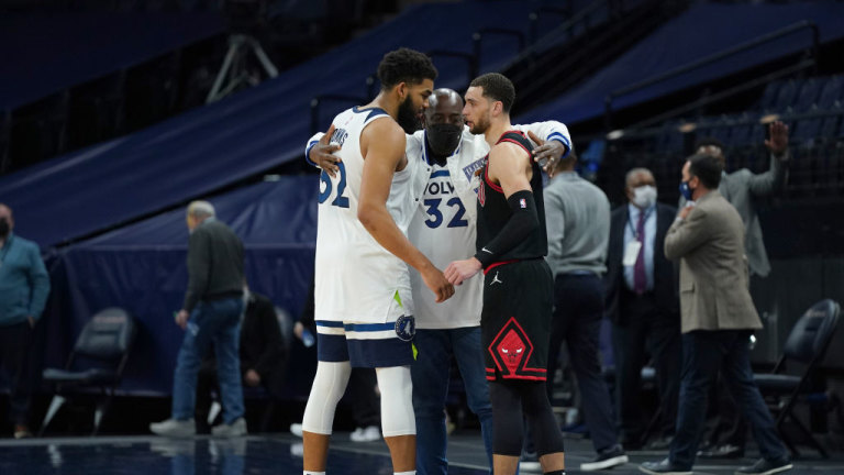 Sunday, April 11: Karl Towns Sr., Karl-Anthony Towns and Zach LaVine of the Bulls hug after the game.