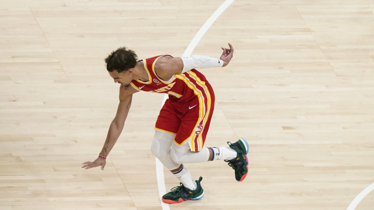 Atlanta Hawks guard Trae Young (11) celebrates after shooting and scoring against the New York Knicks during the second half in Game 3 of their first-round playoff series Friday, May 28, 2021, in Atlanta. (AP Photo/Brynn Anderson)