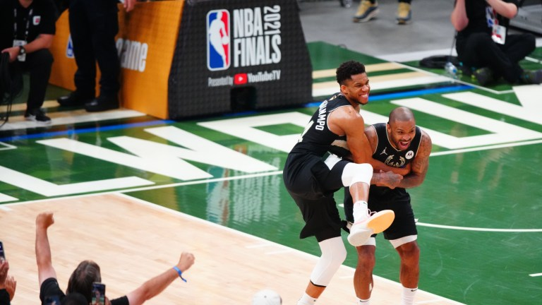 Milwaukee Bucks forward Giannis Antetokounmpo celebrates with forward P.J. Tucker during Game 6 of the 2021 NBA Finals against the Phoenix Suns at Fiserv Forum.
