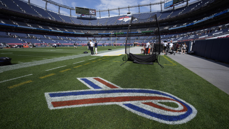 A red, white and blue ribbon, to mark Sept. 11, 2001 anniversary, marks the field near the Texas A&M bench in Denver. (AP Photo/David Zalubowski)
