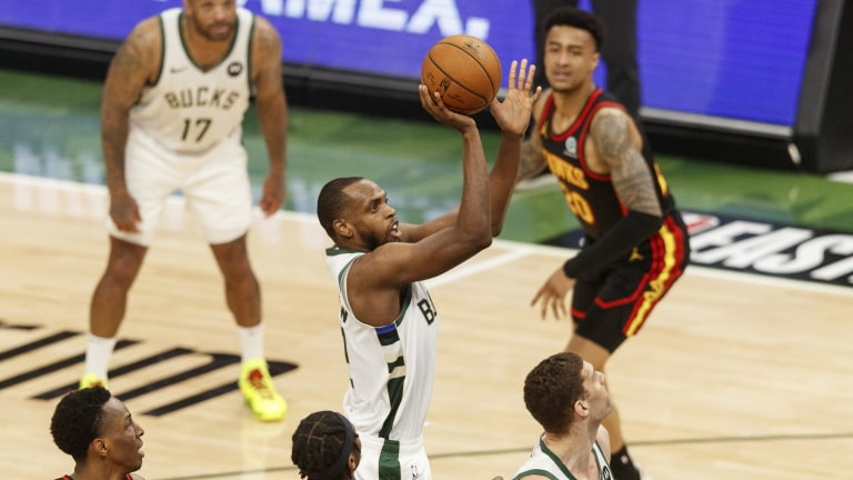 Khris Middleton (22) shoots during the second quarter against the Atlanta Hawks during game five of the Eastern Conference Finals for the 2021 NBA Playoffs at Fiserv Forum. Mandatory Credit: Jeff Hanisch-USA TODAY Sports