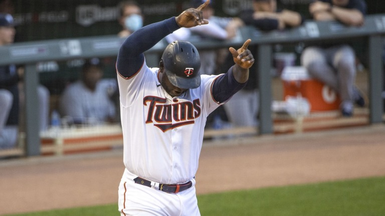 Tuesday, June 8: Twins first baseman Miguel Sano (22) celebrates after scoring a run in the first inning against the New York Yankees at Target Field.