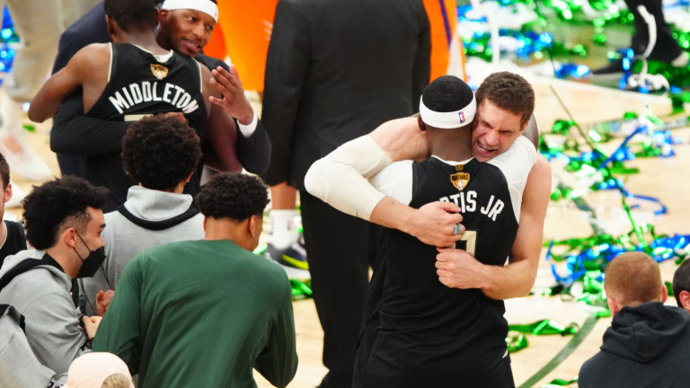 Milwaukee Bucks center Brook Lopez celebrates with Bobby Portis after defeating the Phoenix Suns during Game 6 of the 2021 NBA Finals at Fiserv Forum.