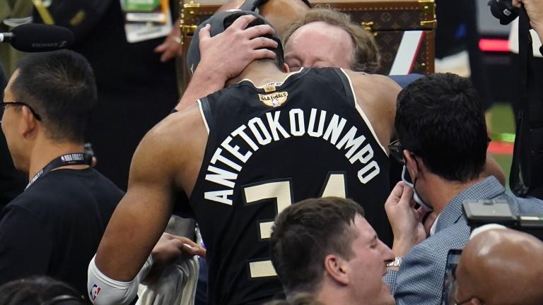 Milwaukee Bucks forward Giannis Antetokounmpo (34) hugs Milwaukee Bucks head coach Mike Budenholzer after defeating the Phoenix Suns in Game 6 of basketball's NBA Finals in Milwaukee, Tuesday, July 20, 2021. The Bucks won 105-98. (AP Photo/Paul Sancya)