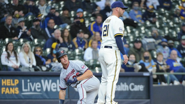 Thursday, April 1: Max Kepler slides safely into third base during the Minnesota Twins' 6-5 loss to Milwaukee on opening day.