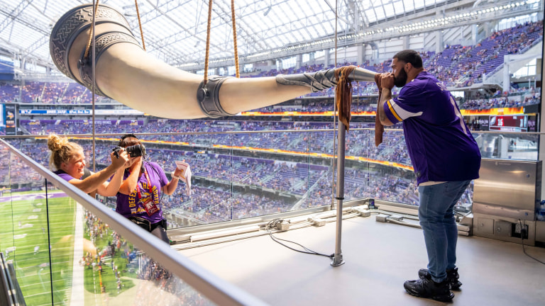 Saturday, Aug. 15: University of Minnesota Olympic Gold medalist Gable Steveson blows the Gjallarhorn before the game between the Minnesota Vikings and Denver Broncos at U.S. Bank Stadium.