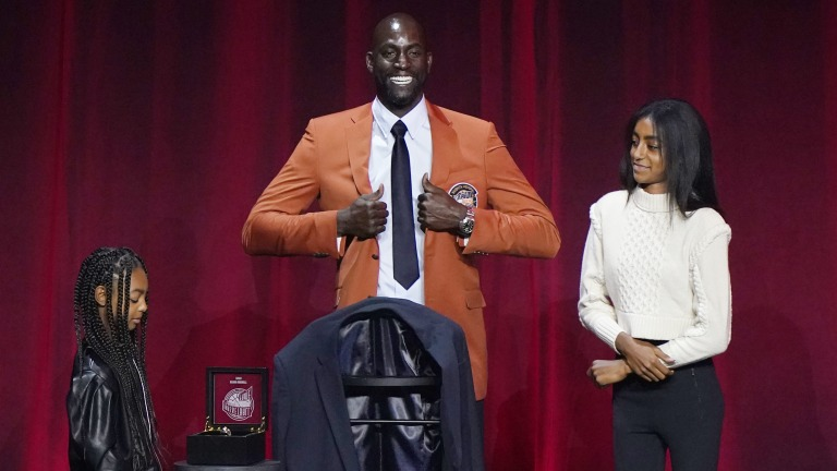 Saturday, May 15: Kevin Garnett smiles as he adjusts his Hall of Fame jacket presented by his daughters Kavalli, left and Kapri at the 2020 Basketball Hall of Fame awards tip-off celebration and awards gala.