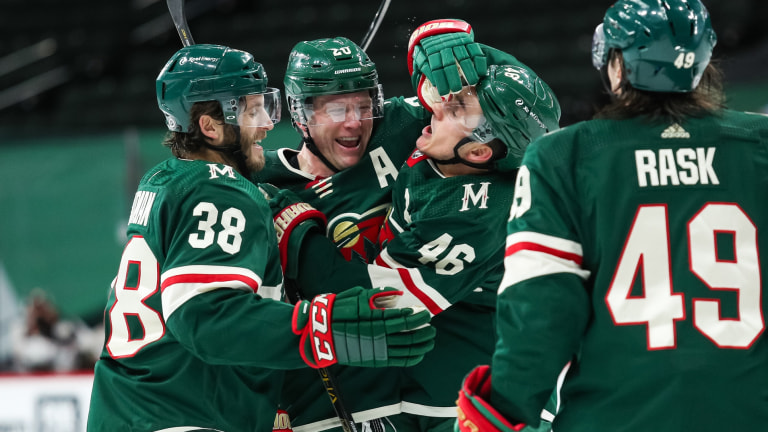 Monday, March 22: Wild defenseman Ryan Suter celebrates with teammates after scoring a power play goal against the Anaheim Ducks.